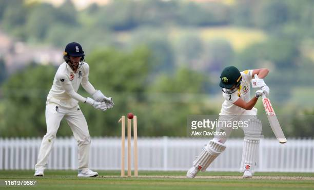 Molly Strano of Australia A is bowled by Heather Knight of England as Amy Jones of England watches on during Day Three of the International Friendly...