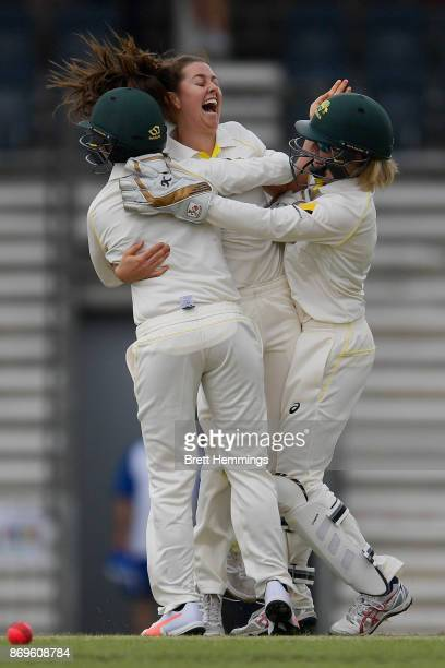 Molly Strano of CAXI celebrates with team mates after taking the wicket of Tamsin Beaumont of England during day one of the Women's Tour match...