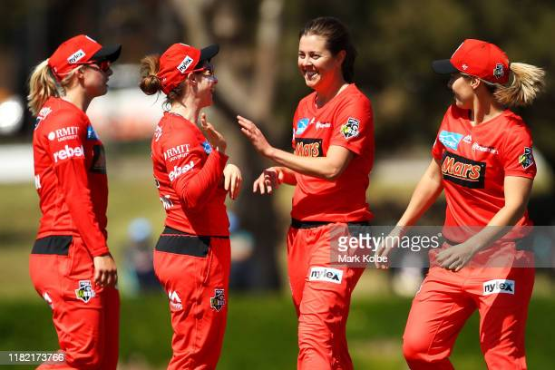 Molly Strano of the Renegades celebrates with her team mates after taking the wicket of Tahlia McGrath of the Strikers during the Women's Big Bash...