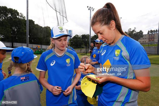 Molly Strano signs autographs for fans during a Southern Stars training session at Melbourne Cricket Ground on February 18 2017 in Melbourne Australia
