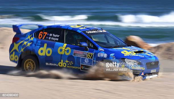Molly Taylor of Australia lands after a jump in her Subaru STI rally car during the first day of the World Rally Championship event the Rally of...