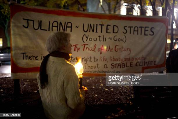 Molly Wilcox, of Damariscotta, during a candlelight rally organized by 350 Maine in support of the plaintiffs in Juliana vs. The United States in...