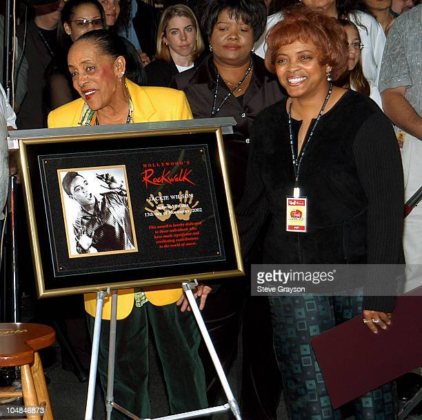 Molly Wilson widow of the late singer Jackie Wilson and daughter Sabrina admire a plaque honoring Wilson's induction into the RockWalk of Fame