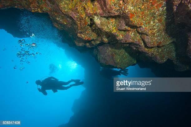 Molokini, Maui, Hawaii, USA; Scuba diver at a volcanic crater
