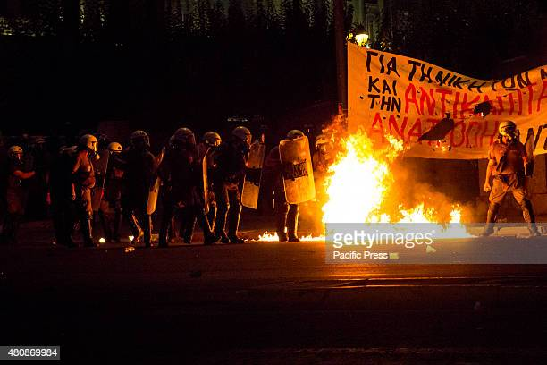 A molotov bomb explodes in front of riot policemen Unions gather in Syntagma square to protest against the voting of the new austerity measures by...