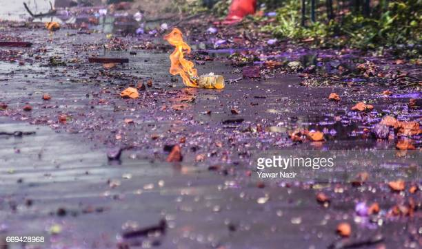 Molotov cocktail thrown by a Kashmiri student towards Indian government forces lies on a road during a protest against the attack by Indian...