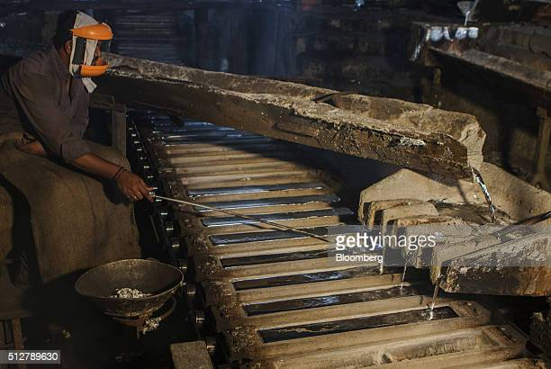 Molten aluminum is poured from a furnace into molds at a Sargam Metals Ltd aluminum recycling facility in Chennai Tamil Nadu India on Thursday Feb 25...