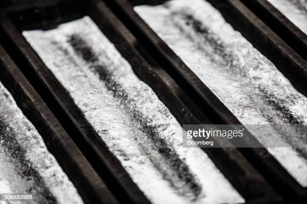 Molten aluminum sits inside ingot moulds at the Alumetal Group Hungary Kft aluminium processing plant in Komarom Hungary on Monday March 19 2018 The...