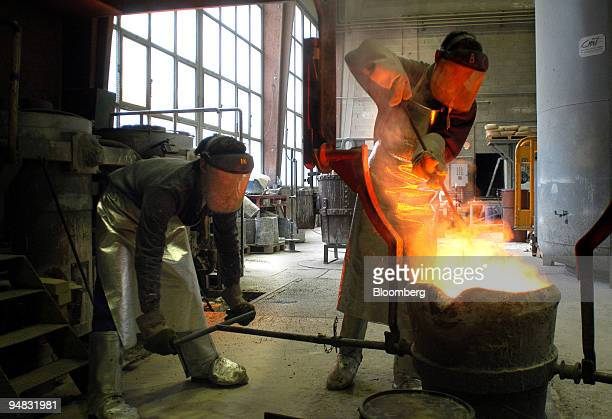 Molten bronze is poured for the casting of a sculpture by Greg Wyatt at the Fonderie de Coubertin near Paris France Wednesday February 16 2005 Wyatt...