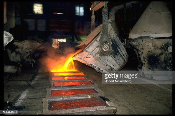 Molten copper being poured into ingot molds at ex-def