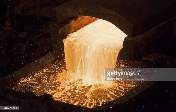 Molten copper flows from a furnace into a mould at the copper mining and smelting complex operated by RTB Bor Group in Bor Serbia on Tuesday Feb 28...