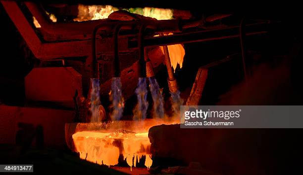 Molten copper is cast into copper anodes in the foundry of Aurubis AG an employee is controlling the melting and casting process on February 7 2014...