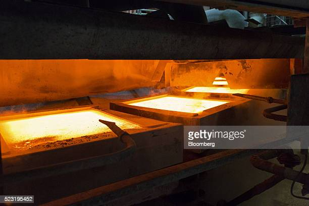 Molten copper sits in casting molds during the production of anode plates at the Aurubis AG metals plant in Hamburg Germany on Thursday April 21 2016...