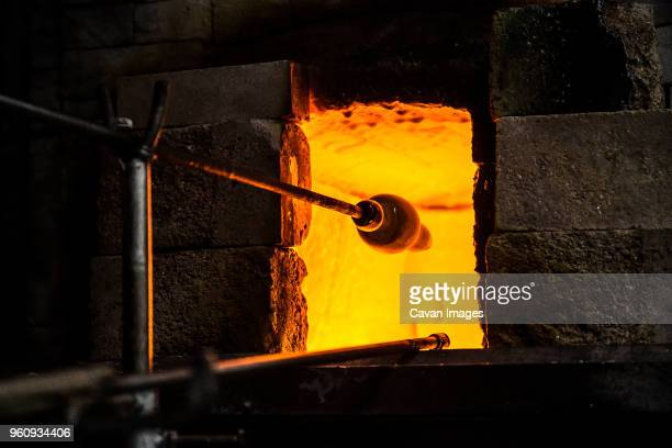 molten glass at furnace in workshop - blowpipe stock pictures, royalty-free photos & images