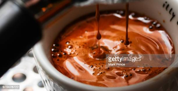 molten lava espresso - extreme close up stock pictures, royalty-free photos & images
