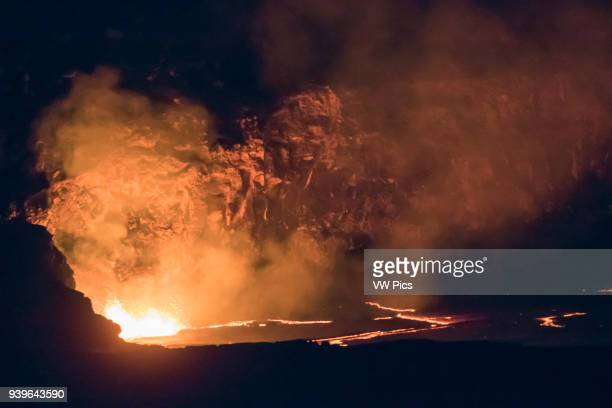 Molten lava in Kilauea Caldera fountains and lights the rim Hawaii Volcanoes National Park Big IslandHawaii