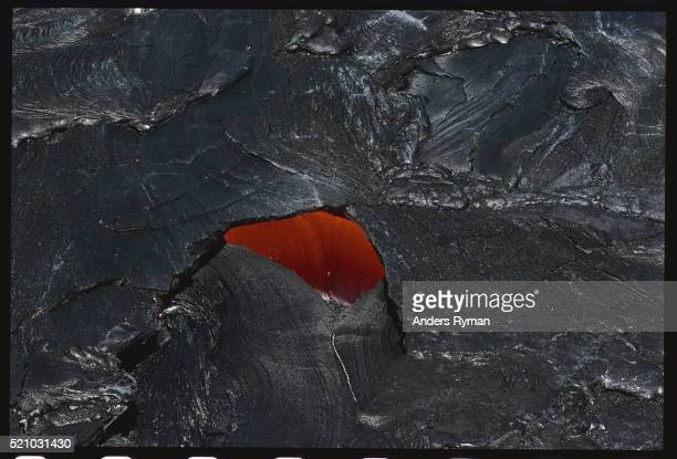 molten lava under lava crust - pu'u o'o vent stock pictures, royalty-free photos & images