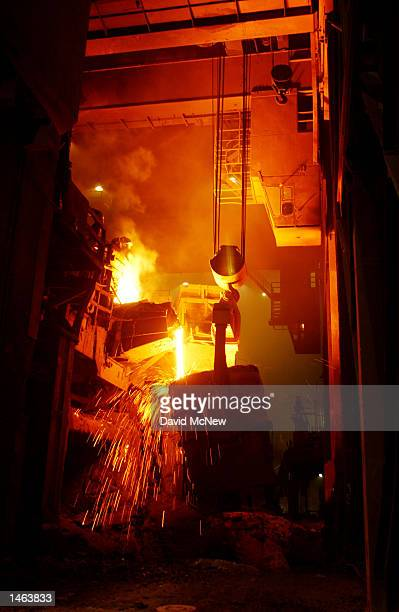 Molten steel is poured from the furnace into a ladle at the TAMCO steel mini mill on October 4 2002 in Rancho Cucamonga California TAMCO California's...