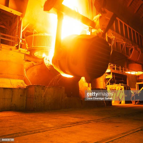Molten steel is poured out of a massive ladle and super heated as a part of steel production at Llanwern Steel Works near Newport in Gwent South...