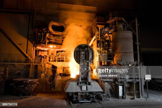 Molten steel is poured out of an electric arc furnace in the ArcelorMittal factory in Hamburg Germany 14 July 2017 The company the world's largest...