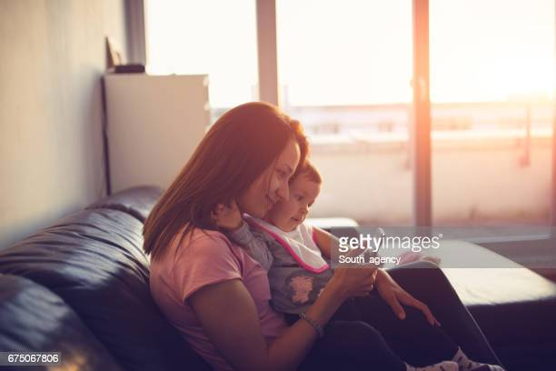 Mom and baby at home relaxing
