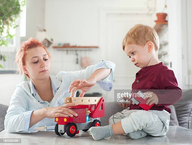 mom and baby boy - adjusting stock pictures, royalty-free photos & images