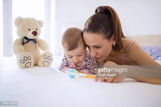 mom and baby having fun and playing in bedroom - mama bear stock photos and pictures