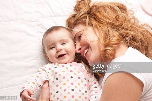mom and baby smiling
