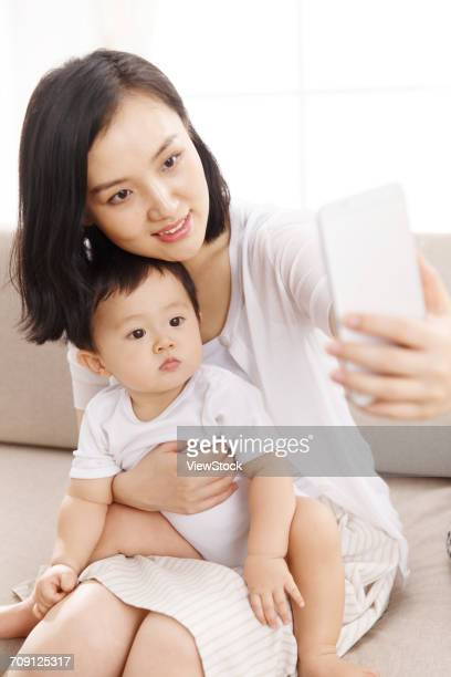 Mom and baby taking selfie photo