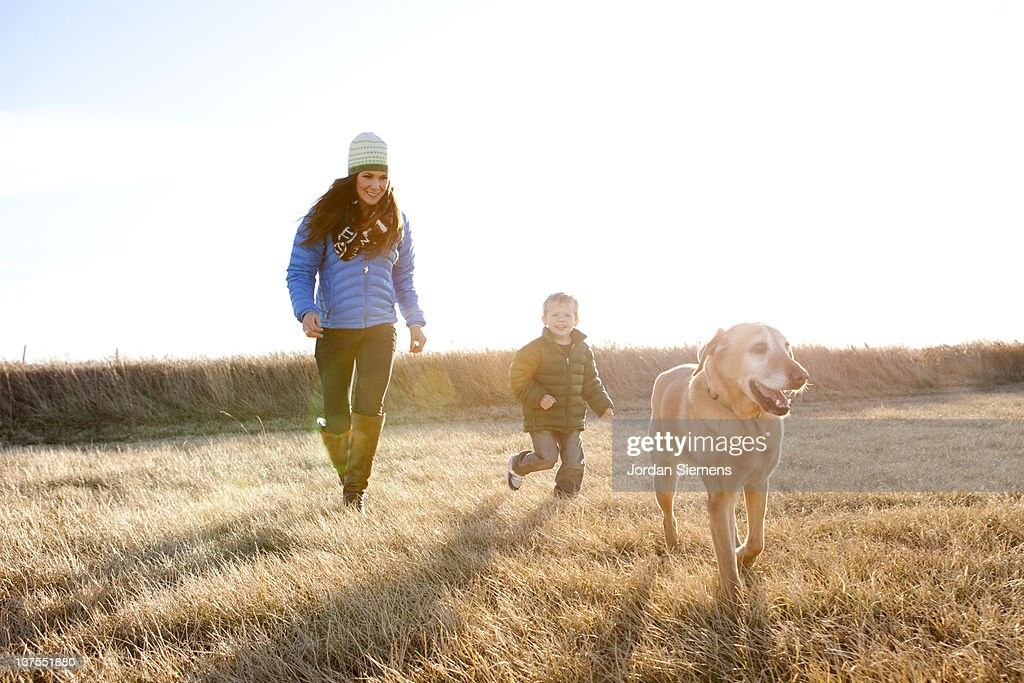 Mom and boy playing in the outdoors. : Stock Photo