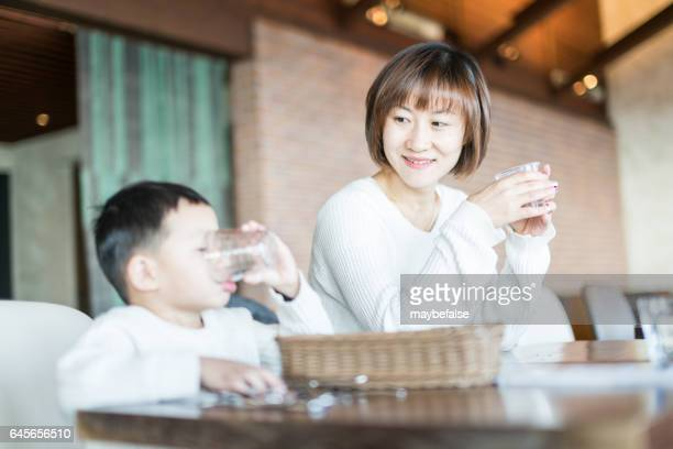 mom and child in a cafeteria