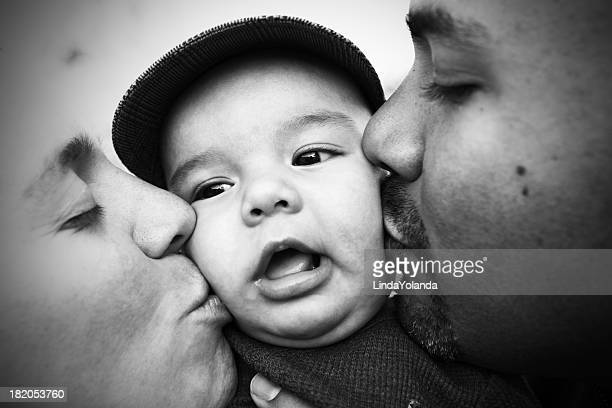 Mom and Dad Kissing Baby