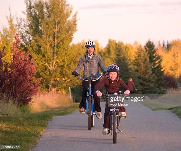Mom and daughter biking