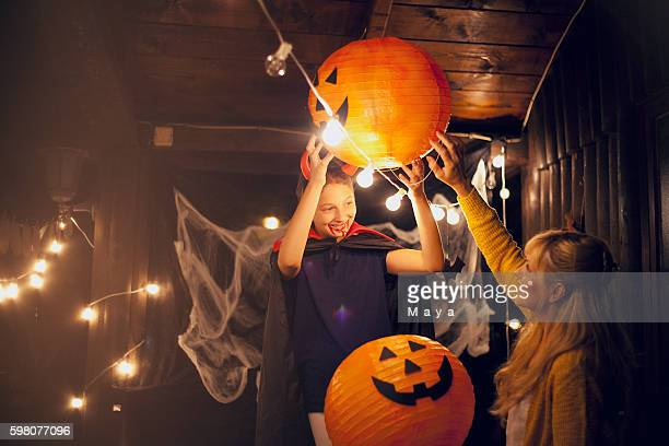 mom and daughter decorate for halloween - decoration stock pictures, royalty-free photos & images