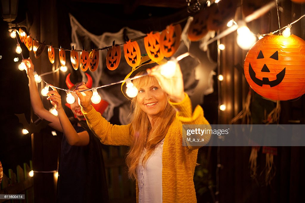 Mom and daughter decorate for Halloween : Stock Photo