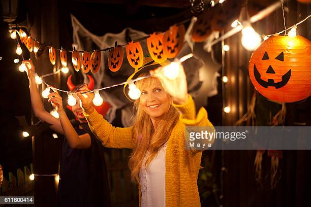 Mom and daughter decorate for Halloween