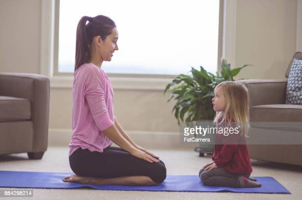 mom and daughter do yoga together - mindfulness stock pictures, royalty-free photos & images