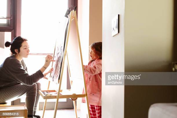 Mom and daughter drawing at home