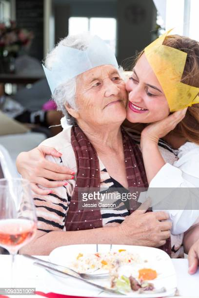 Mom and daughter embracing at Christmas lunch