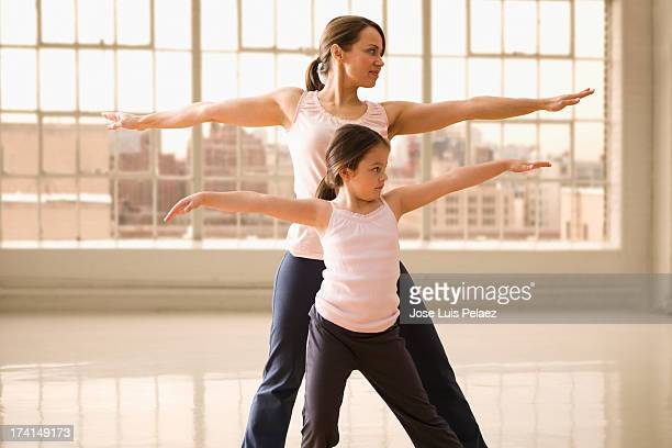 Mom and Daughter Exercising