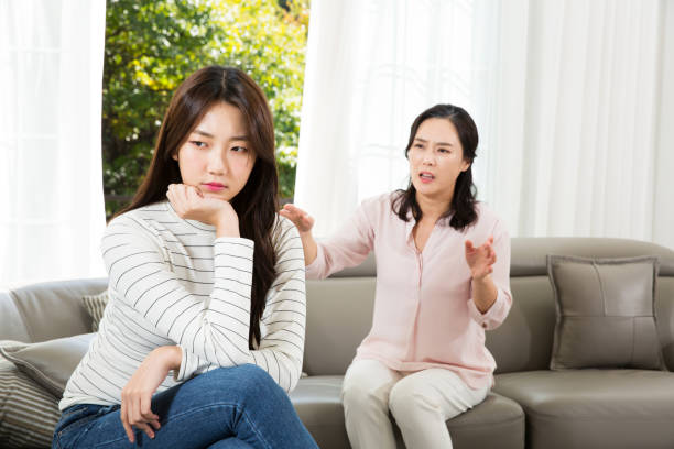 mom and daughter having an argument (communication gap) - asian mother fighting with her daughter stock pictures, royalty-free photos & images