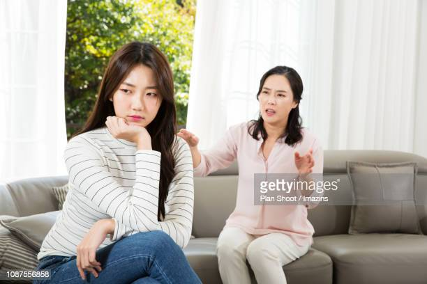 mom and daughter having an argument (communication gap) - mother scolding stock pictures, royalty-free photos & images