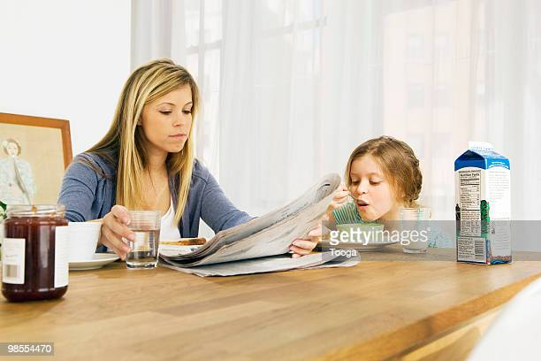 mom and daughter having breakfast - milk carton stock photos and pictures