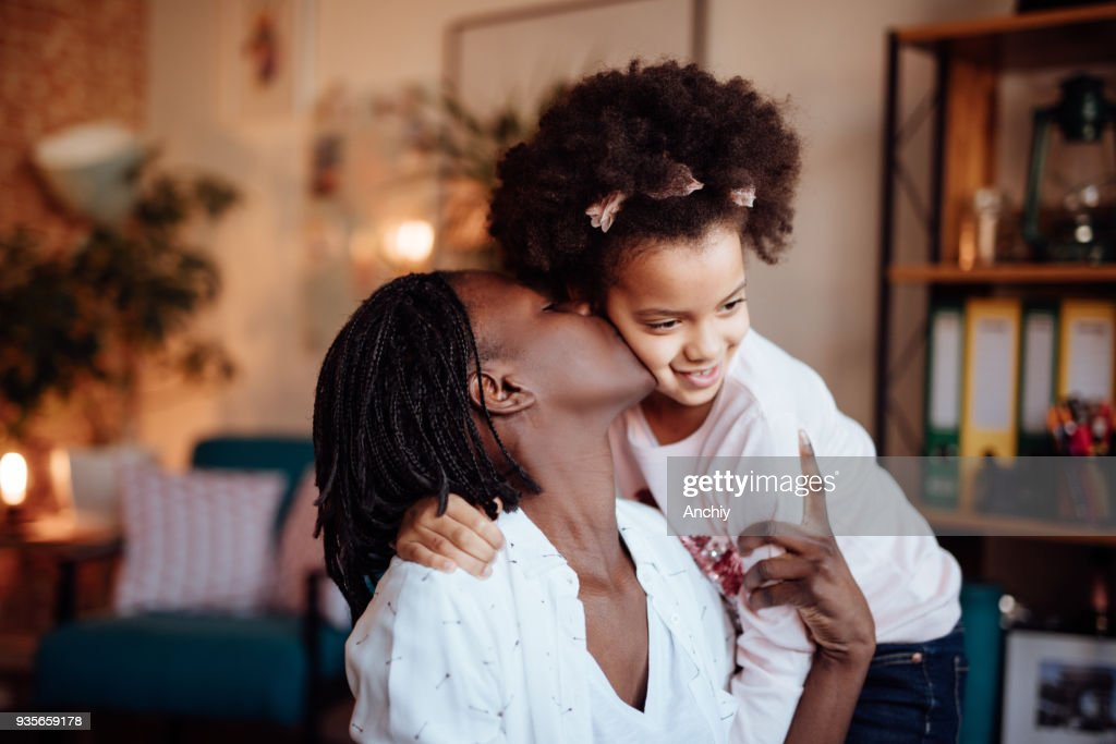 Mom and daughter hugging and kissing : Stock Photo