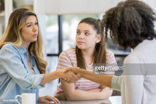 Mom and daughter meet with counselor