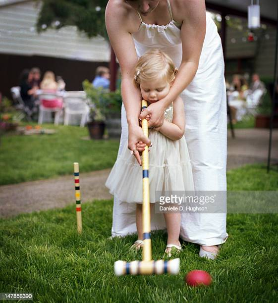 Mom and daughter playing croquet
