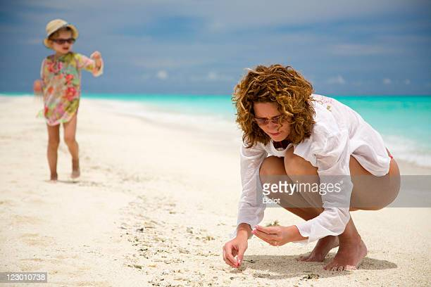 Mom and daughter playing on beach
