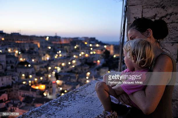 Mom and daughter watching the sunset in Matera
