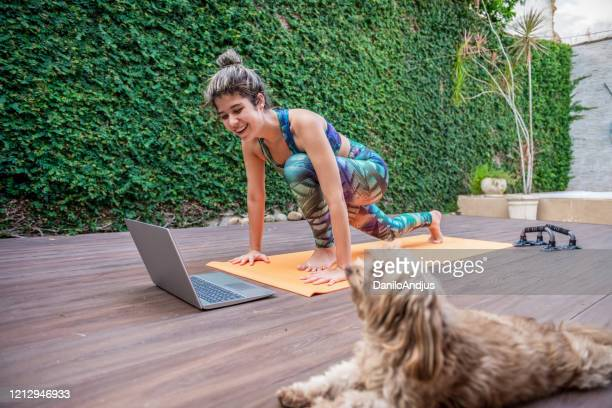 mom and dog exercise together - home workout stock pictures, royalty-free photos & images