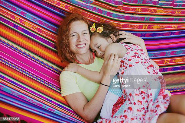 mom and girl in summer in a hammock